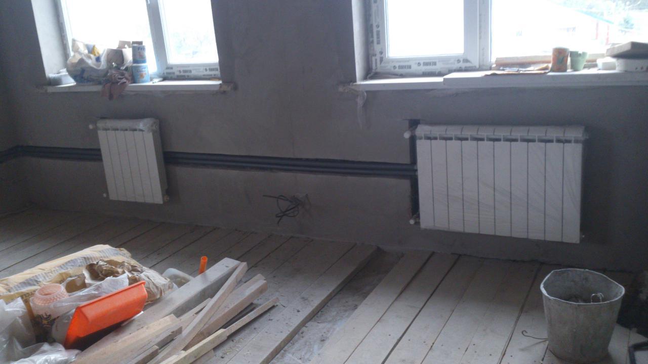 Установка радиаторов и труб отопления