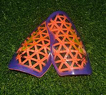Футбольные щитки под гетры Unisport (оранжевые)