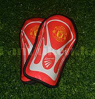 Детские футбольные щитки Manchester United