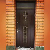 Дверь стальная с ковкой и зашивкой сверху металл с двух сторон