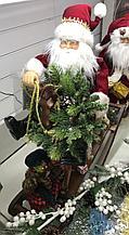 Санта на коне-качалке