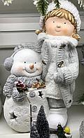 Снеговик с девочкой