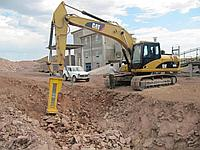 Земляные работы, рытье траншеи при скальном грунте (скальный траншеекопатель, гидромолоты)