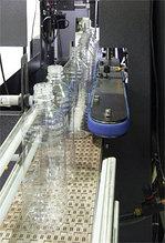 Автоматическая установка для выборки, ориентации и выставления бутылок на конвейер
