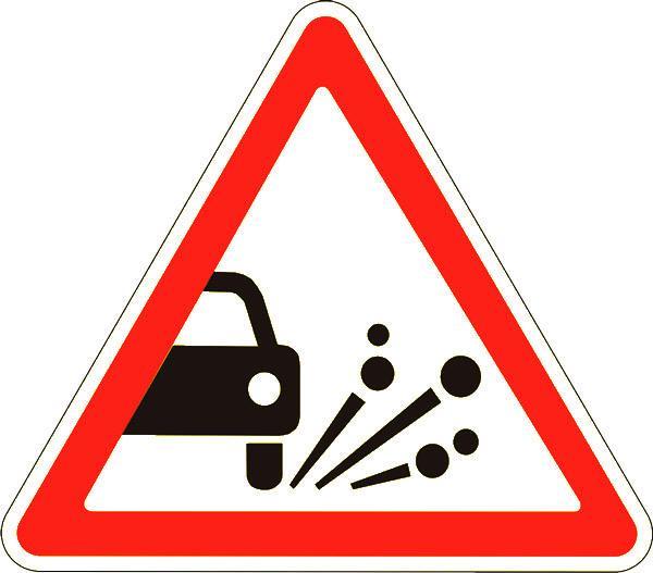 Знак 1.17 Қиыршық тасты шығару/ Выброс гравия