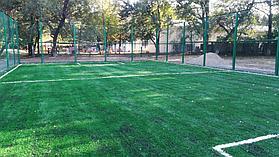 Укладка искусственного газона спортивный 4см и декоративный  с казахскими орнаментами в городе Алматы (Турксибский район) 10