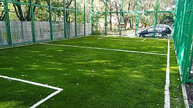 Укладка искусственного газона спортивный 4см и декоративный  с казахскими орнаментами в городе Алматы (Турксибский район) 7