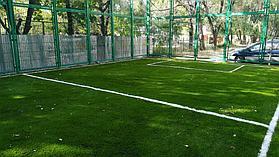 Укладка искусственного газона спортивный 4см и декоративный  с казахскими орнаментами в городе Алматы (Турксибский район) 1