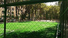 Укладка искусственного газона спортивный 4см и декоративный  с казахскими орнаментами в городе Алматы (Турксибский район) 4