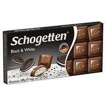 Молочный шоколад Schogetten Сливки и Какао с кусочками печенья Black and White 100гр