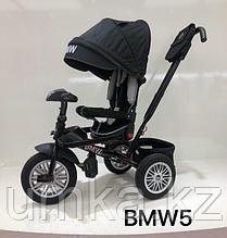 Детский трехколесный велосипед BMW 5 с поворотным сиденьем
