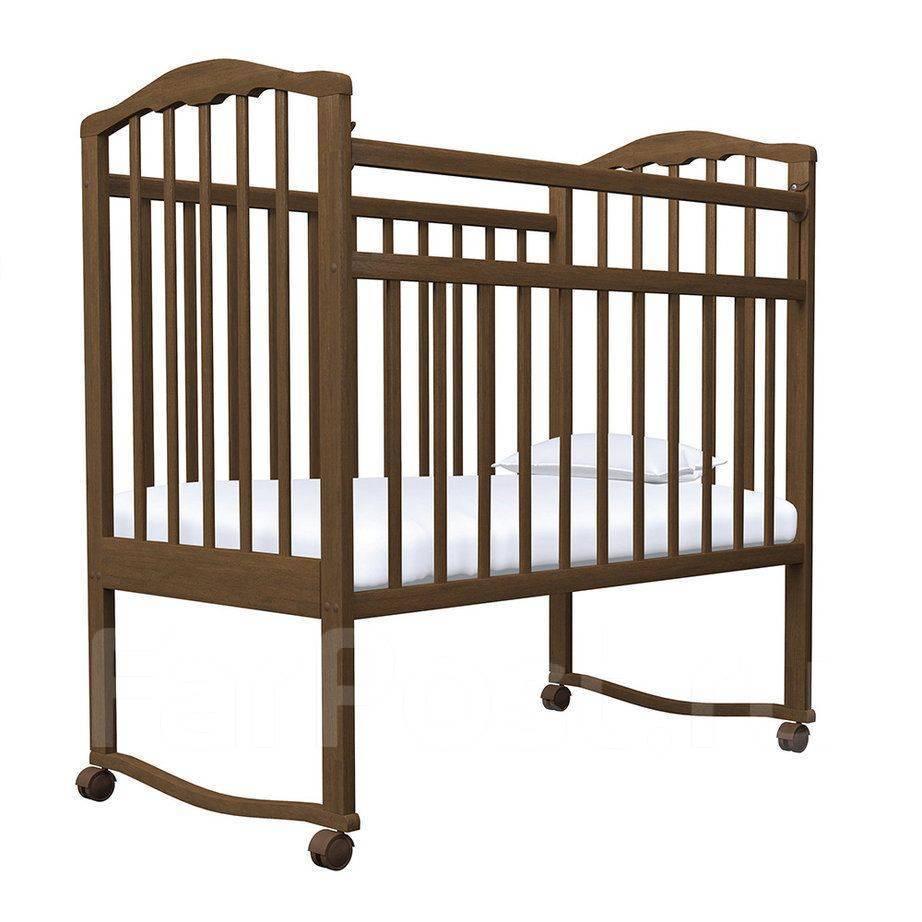 Кровать детская АГАТ ЗОЛУШКА-1 колесо/качалка Орех