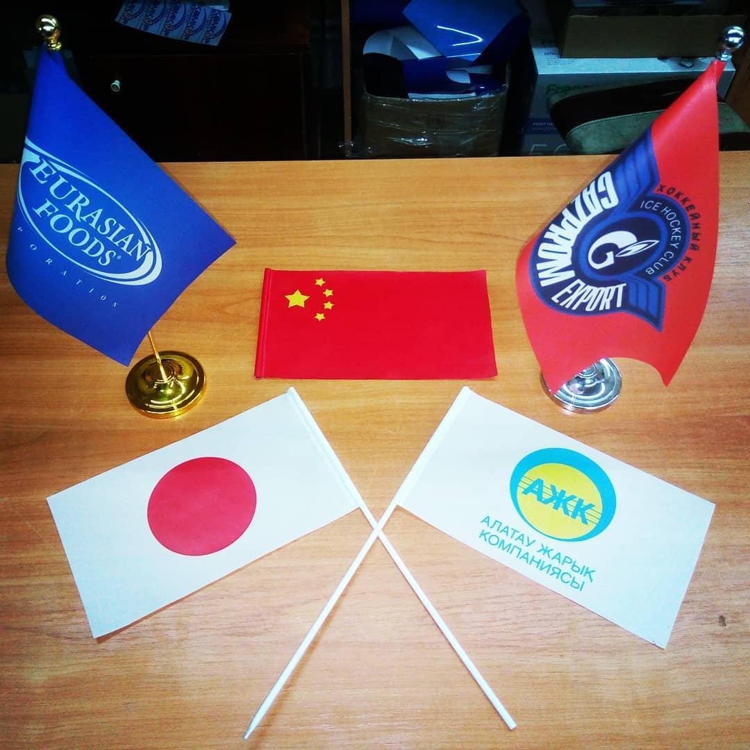 Печать, изготовление флагов, вымпелов, флажков, знамен в Алматы.